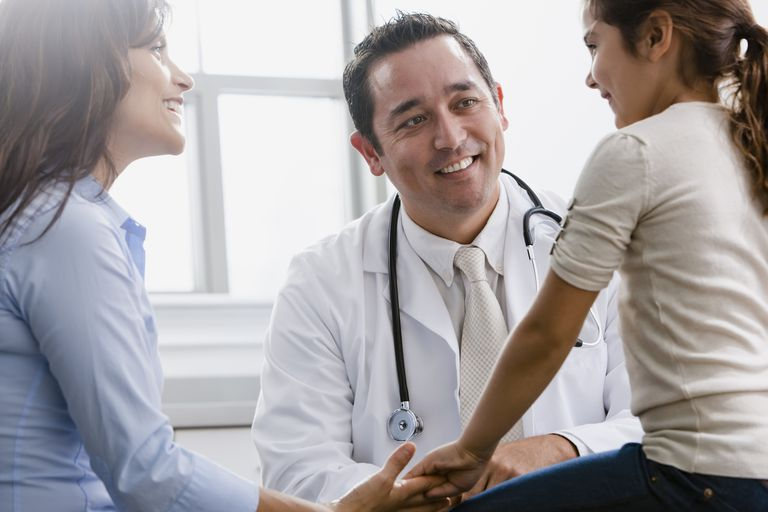 Pediatrician talking to patient and mother