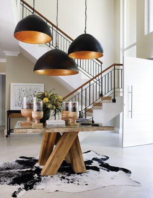 Dining room with designer overhead lights