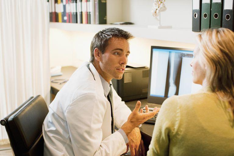 Doctor talking to patient in doctors office