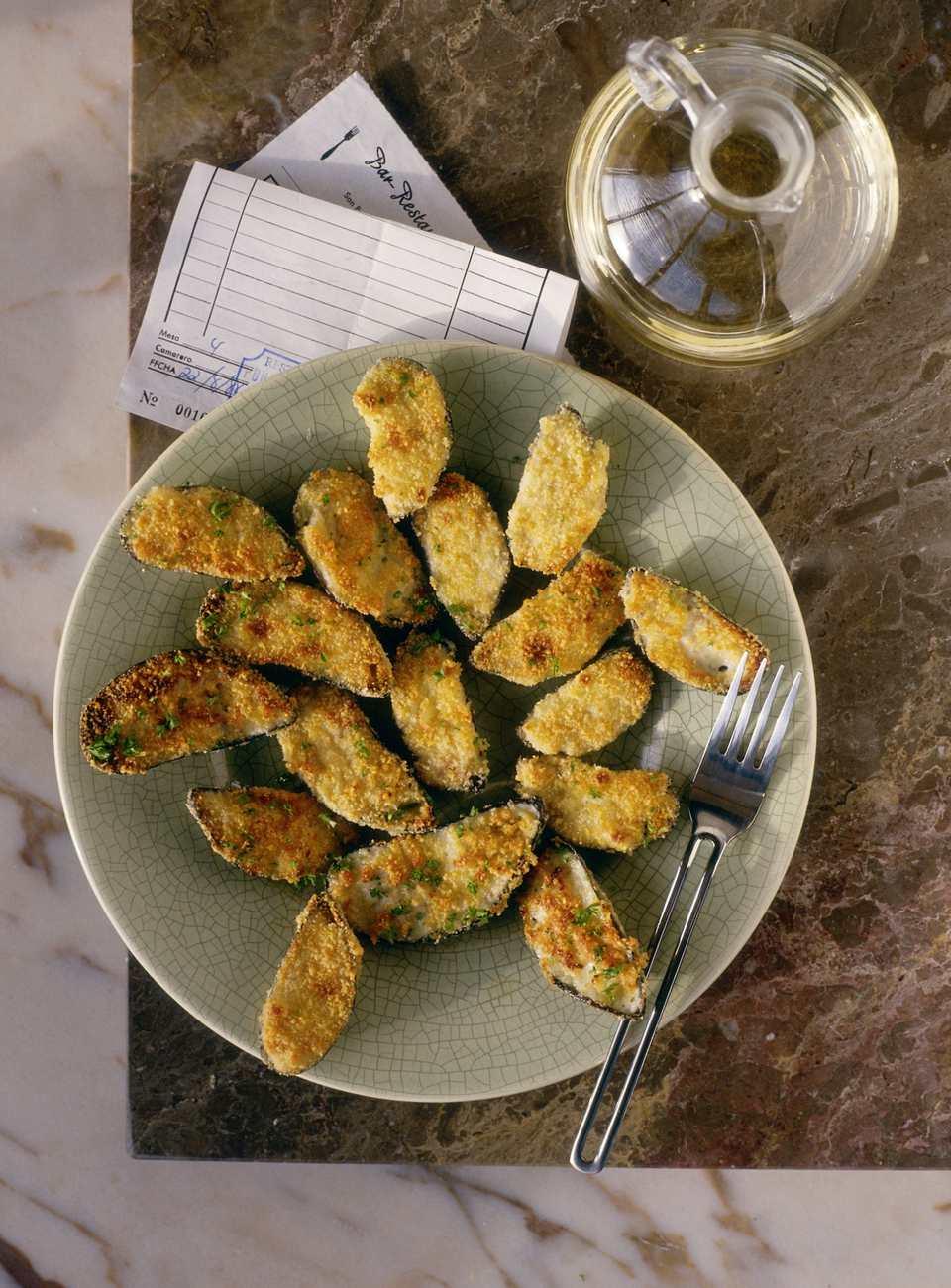 Tapas dish of fried stuffed mussels