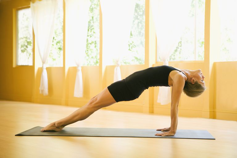 Woman in upward plank yoga pose