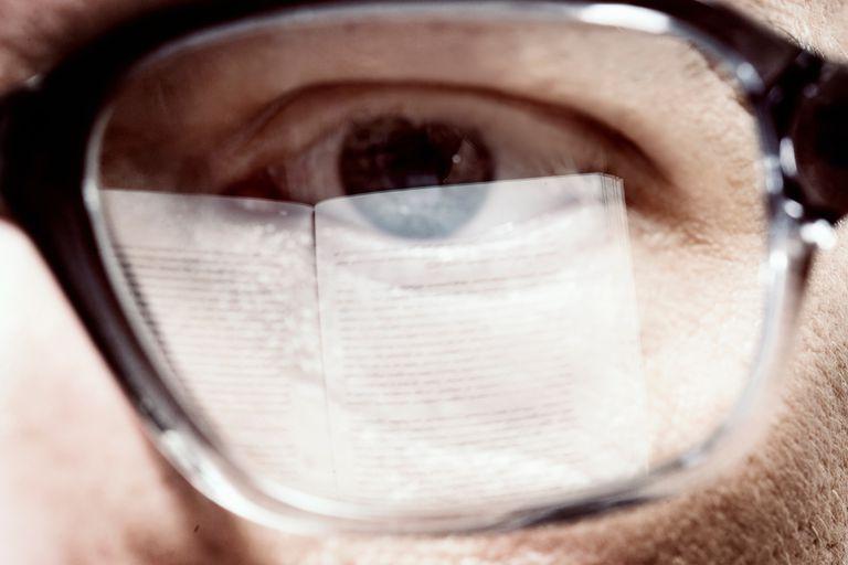 man's eye behind glasses
