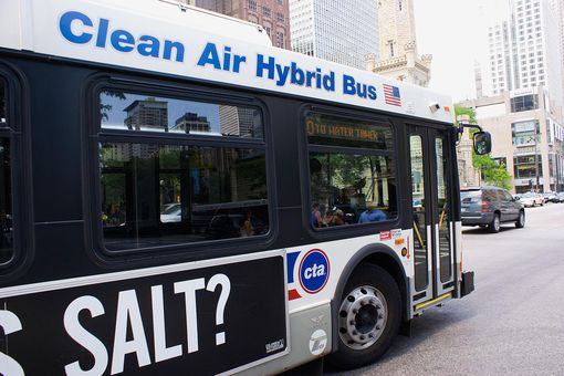 Hybrid bus near Chicago Water Tower, USA