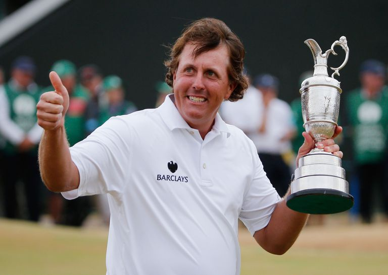 Phil Mickelson of the United States holds the Claret Jug after winning the 142nd Open Championship at Muirfield on July 21, 2013 in Gullane, Scotland