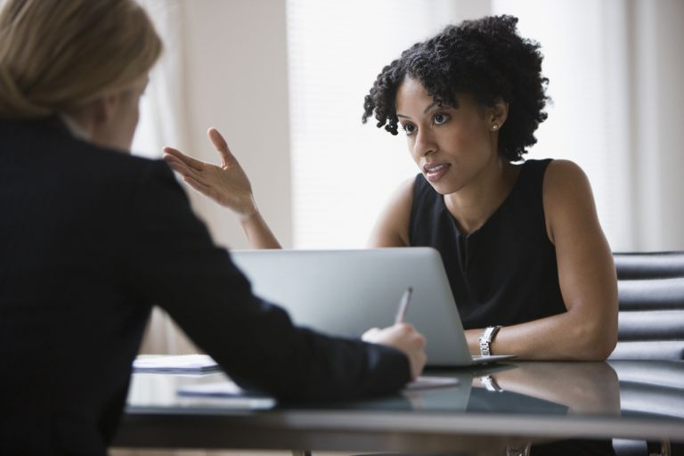Two women discussing in an office.