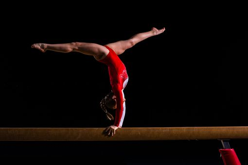 Female gymnast in sports hall