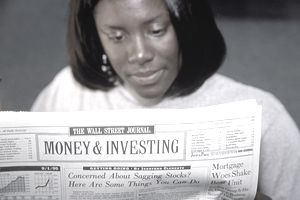 VRT013 Woman reading The Wall Street Journal