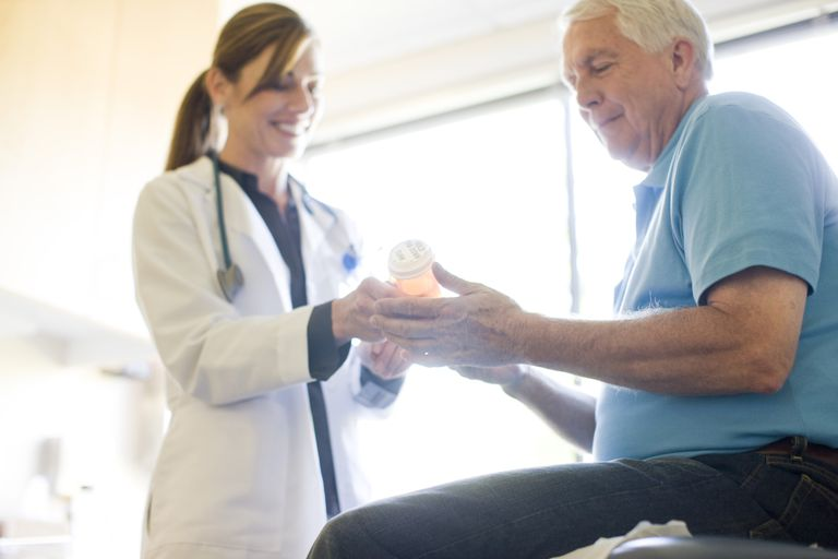 Doctor discussing prescription drugs with patient