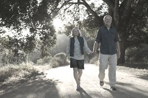 Retired couple taking a walk, happy that they have enough to retire.