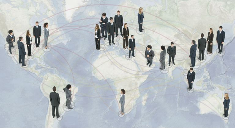 Business people standing on a global map
