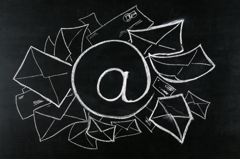 Image of email symbol on a blackboard surrounded by incoming email messages.