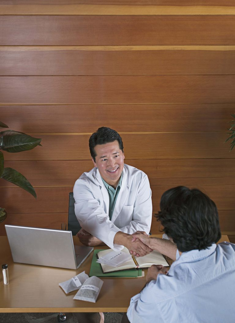 Holistic physician with patient in office
