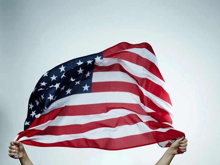 Hands holding American flag.