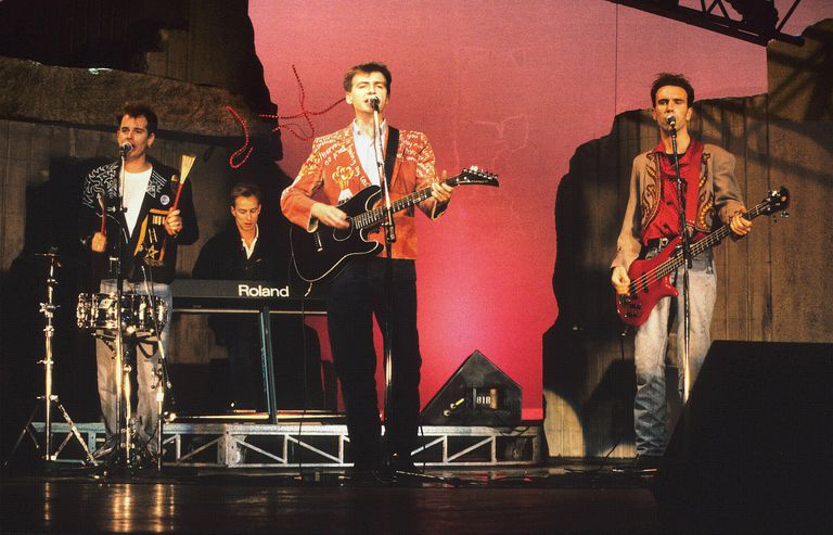 Australian rock band Crowded House performs live during the late '80s.