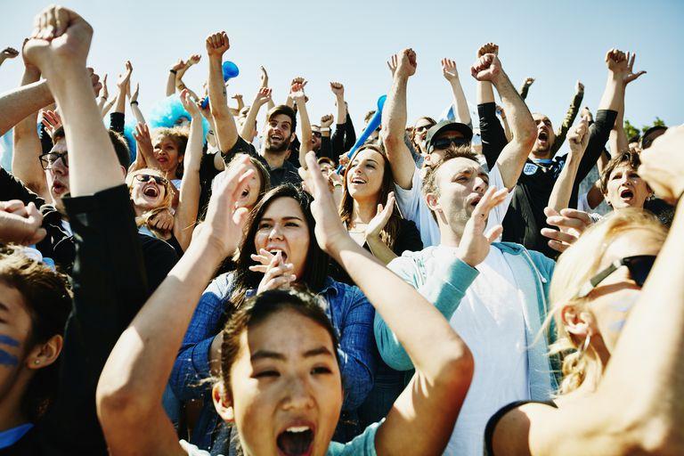Cheering crowd of fans in stadium