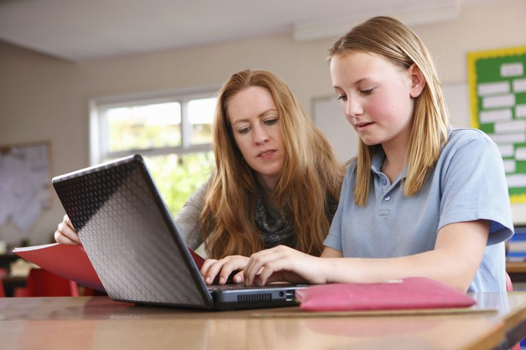 Teacher and Student at a Computer