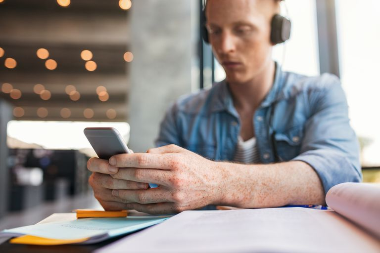 College student using iphone app