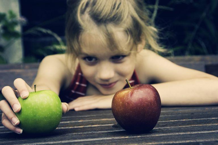 Young girl choosing an apple