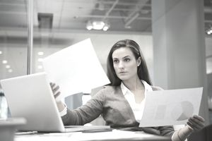 A young businesswoman examining printouts