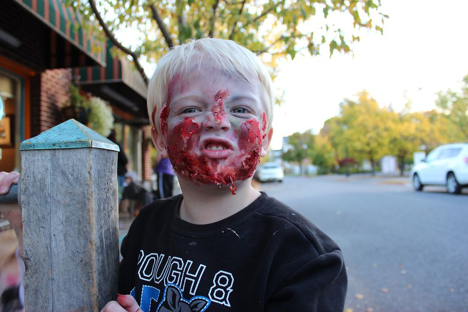 A child with zombie facepaint