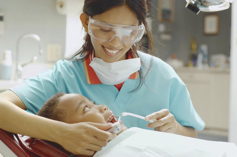female dental assistant working on boy