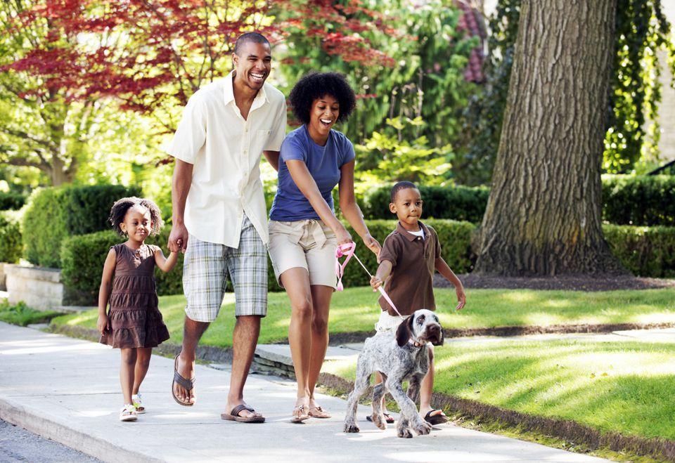 Family Walking Dog in Neighborhood