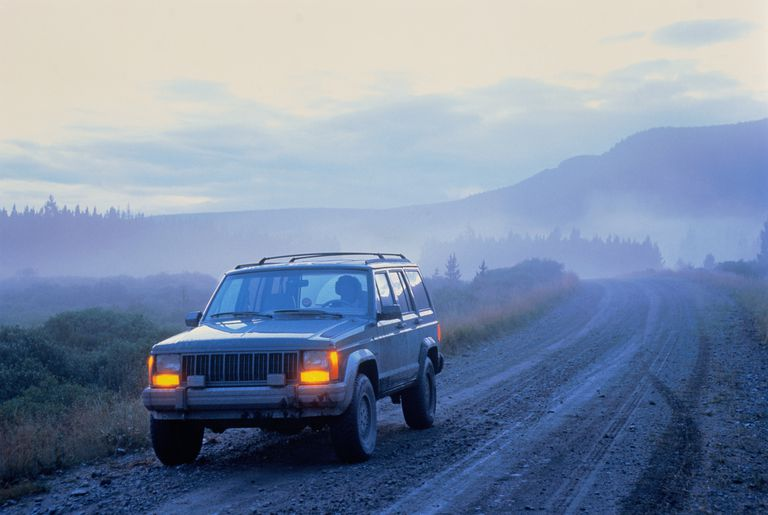 Jeep 4X4 on dirt road at dusk, Canada