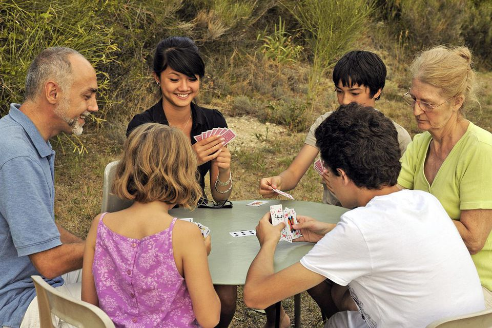 Family playing cards in garden