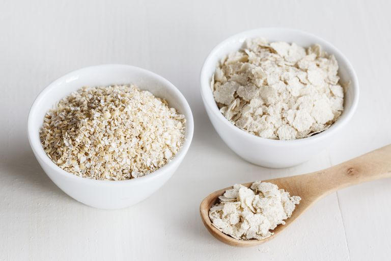 Bowls of oat bran and oat bran flakes