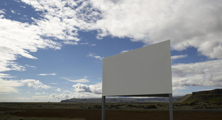 Blank billboard in field