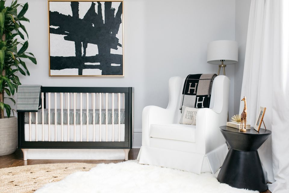Sophisticated and modern nursery in black, white, and gold