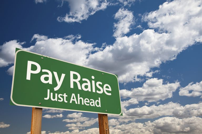 Pay raise just ahead sign - organizations have a variety of approaches to raises.