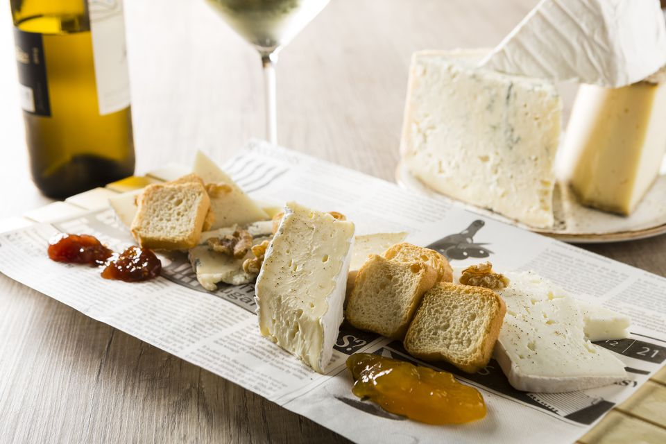 Variety of cheeses served with white wine