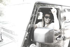Man behind wheels looking out of van