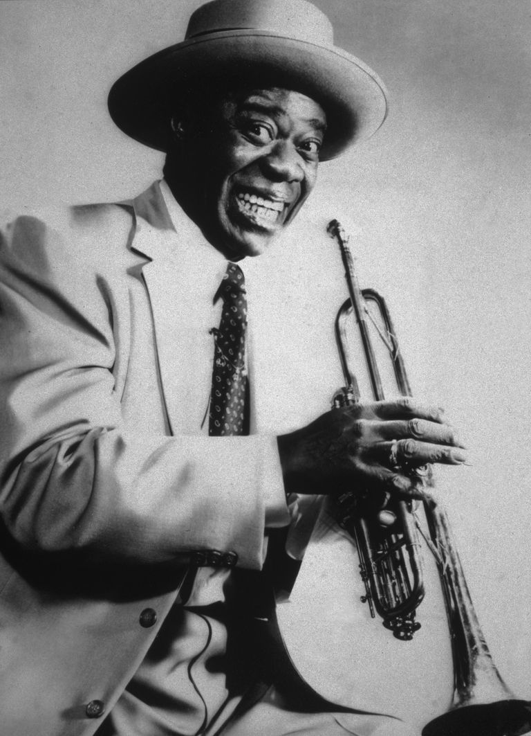 Picture of American jazz musician and bandleader Louis Armstrong holding his trumpet.