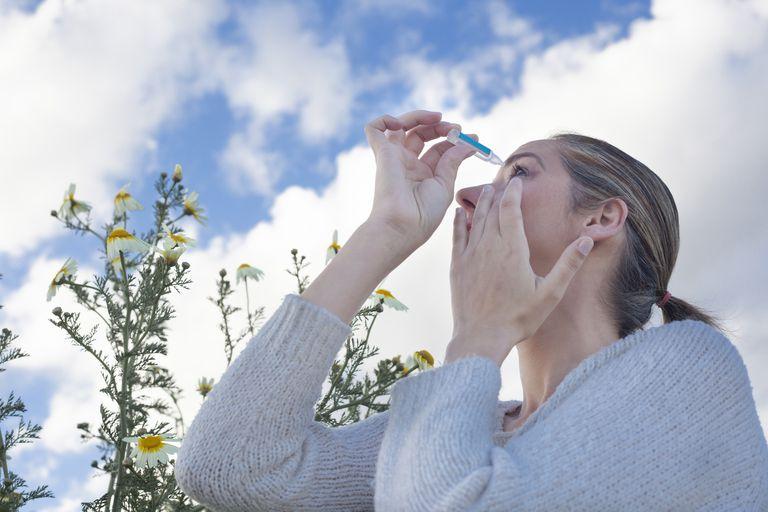 Using eyedropper to treat irritated eyes