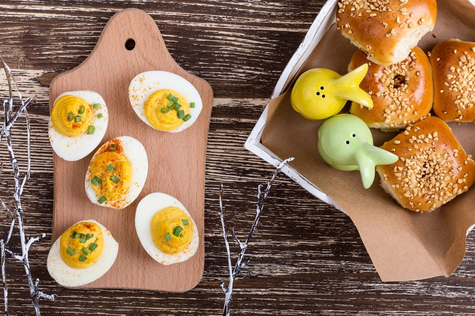 Deviled eggs and homemade buns on Easter table