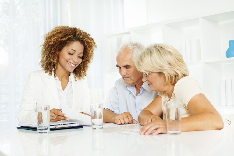 senior couple with financial planner estate planning
