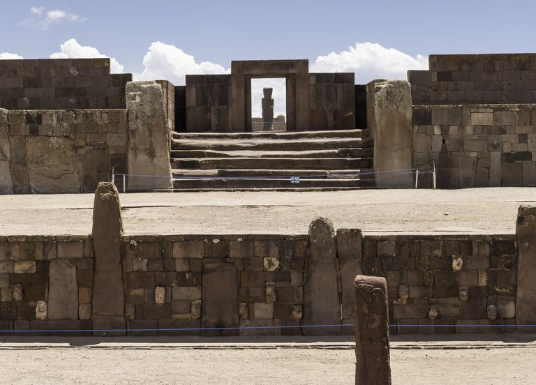 Monolith Ponce viewed through the massive door of Kalasasaya from the Semi-Subterranean Temple, Tiwanaku, Bolivia