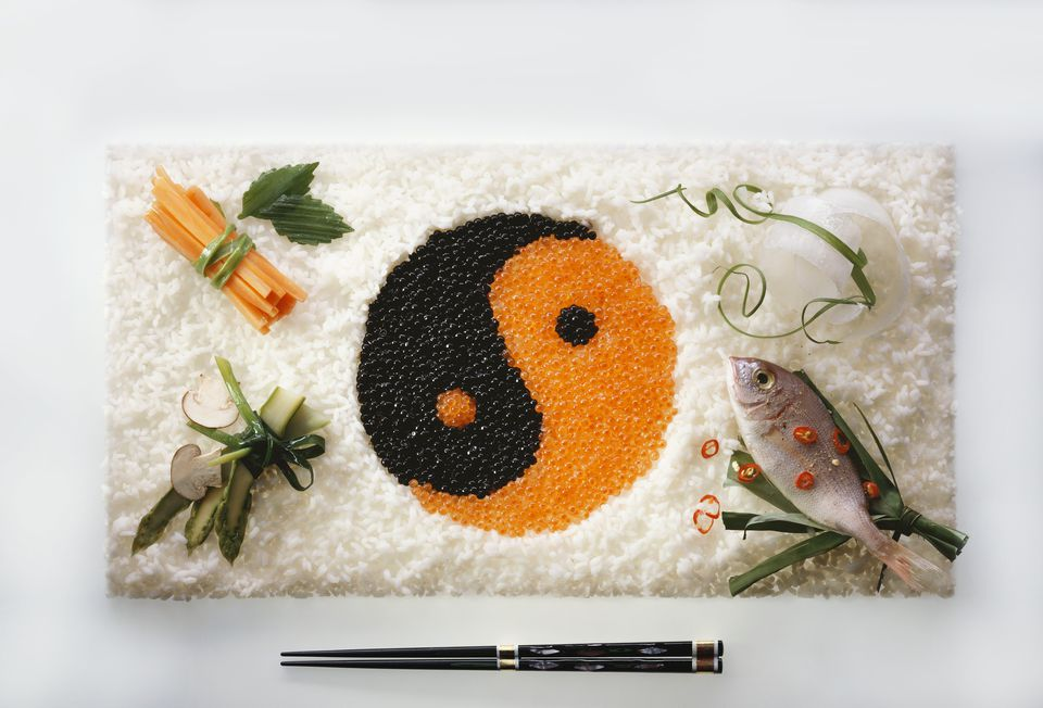 Yin-yang symbol made from caviar in rice