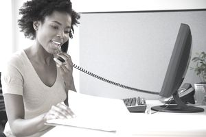 Young woman consulting over the phone about a grant application.