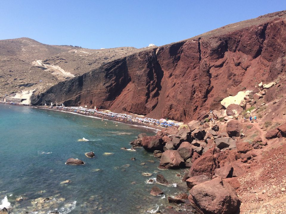 Red Beach In Santorini Against Sky