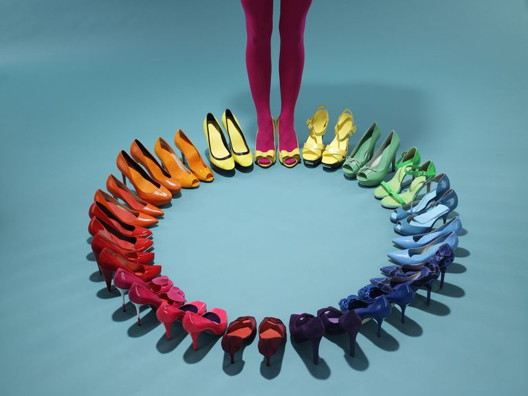 Colorful shoes form a color wheel with legs