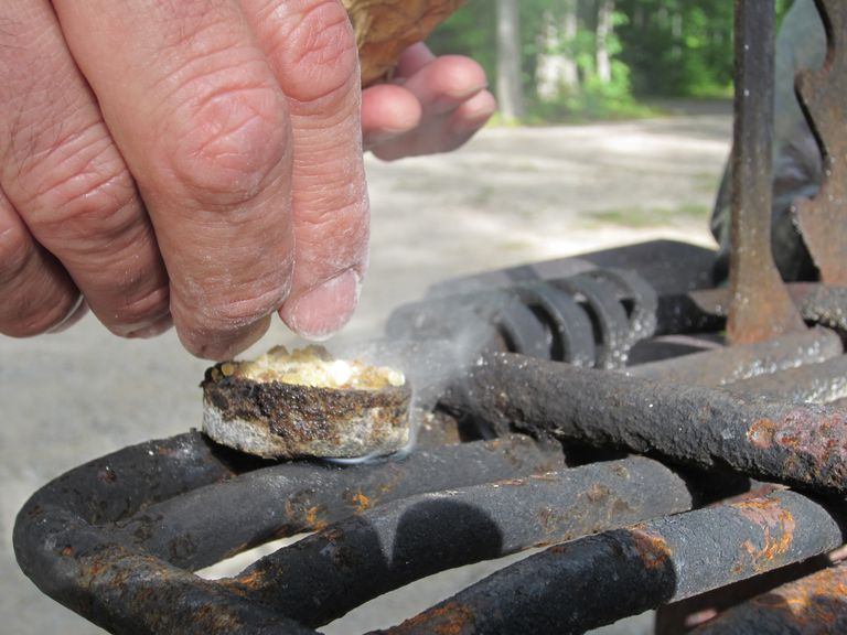 Copal Crystals in a Cast Iron Container Burn on a Grate
