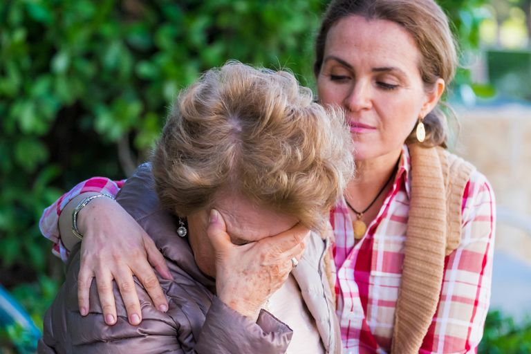 woman giving comfort to another woman