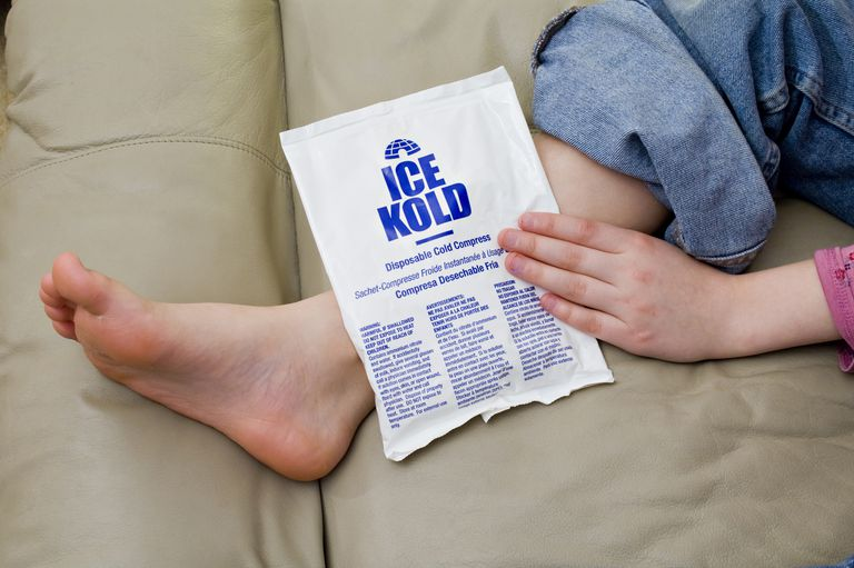 Cold pack placed on injured ankle to reduce swelling. Cold pack contains ammonium nitrate and water, which when mixed together produce an endothermic reaction that is cold.