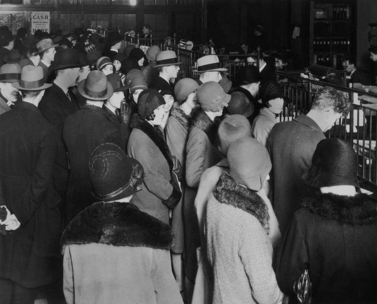Investors rush to withdraw their savings during a stock market crash, circa 1929.