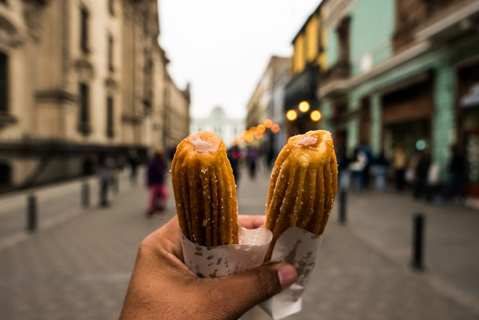 Cropped Hand Holding Churros