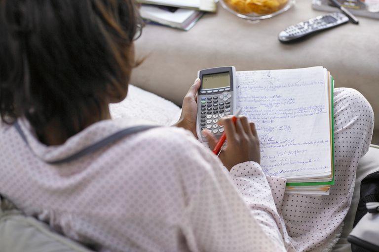 Girl using calculator