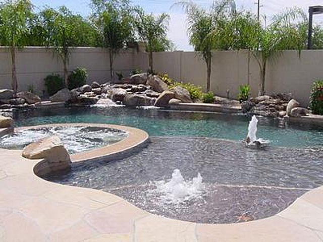 Swimming pools come in a variety of shapes and sizes for Types of swimming pools